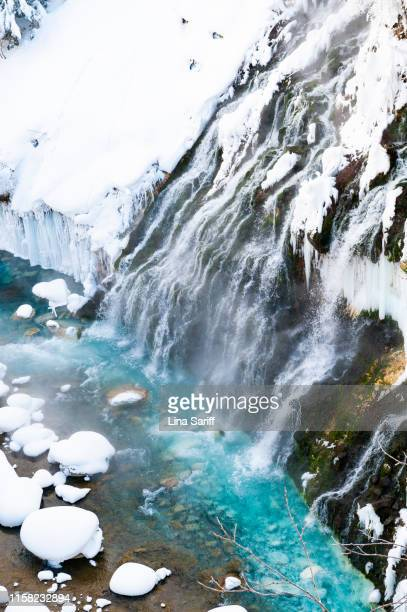 shirahige falls is a spectacular waterfall situated 600 meters above sea level in the town of biei, southeast of asahikawa in hokkaido, japan. - biei town stock pictures, royalty-free photos & images