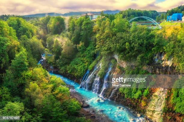shirahige waterfall in biei, hokkaido, japan. - biei town stock pictures, royalty-free photos & images