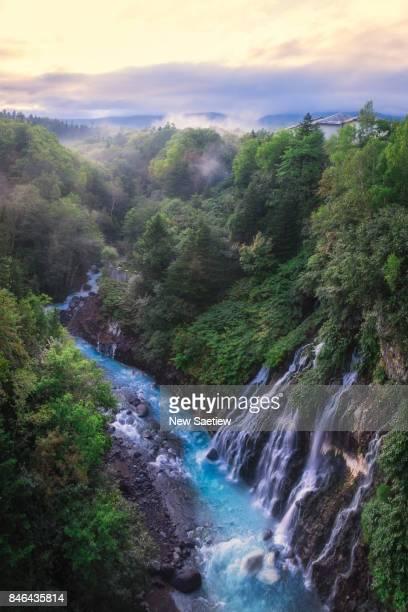 Shirahige Waterfall in Biei, Hokkaido, sunrise time in Japan.