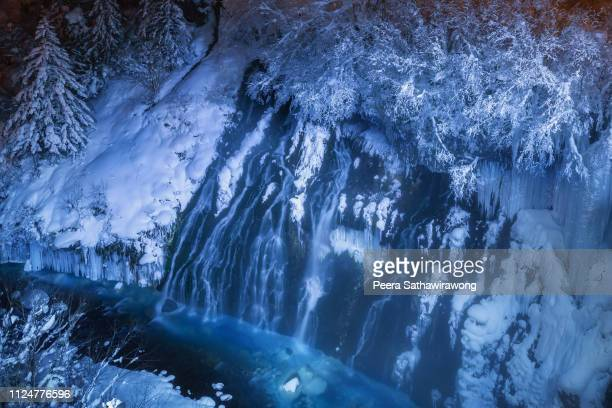 shirahige waterfall winter - biei town stock pictures, royalty-free photos & images