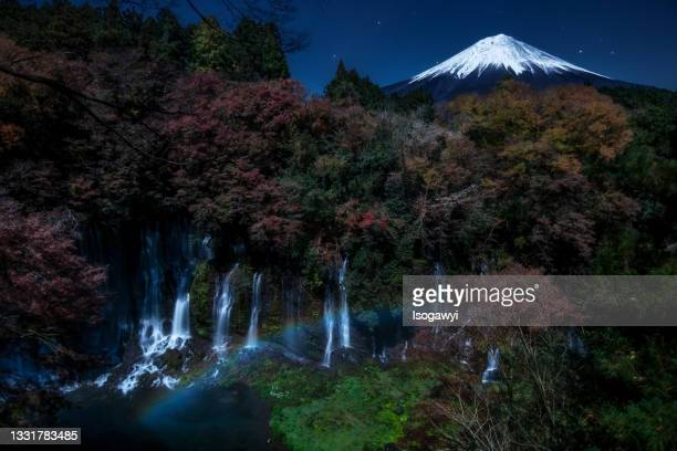 shiraito falls, mt. fuji and moonbow - isogawyi stock pictures, royalty-free photos & images