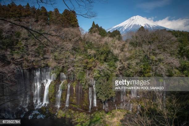 shiraito falls with mt.fuji , japan - fuji hakone izu national park stock photos and pictures