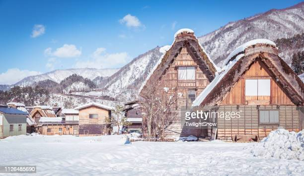 shirakawago village with white snow, the best for tourist travelling in japan at winter - hokuriku region stock photos and pictures