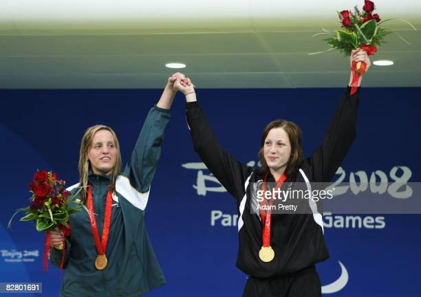 Shireen Sapiro of South Africa and Sophie Pascoe of New Zealand celebrate with their gold medals after dead heating in the Women's 100m Backstroke...