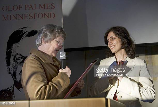 Shirin Ardalan sister of Iranian Parvin Ardalan receives the Olof Palme Prize from Lisbeth Palme on behalf of her sister in Stockholm on March 6 2008...