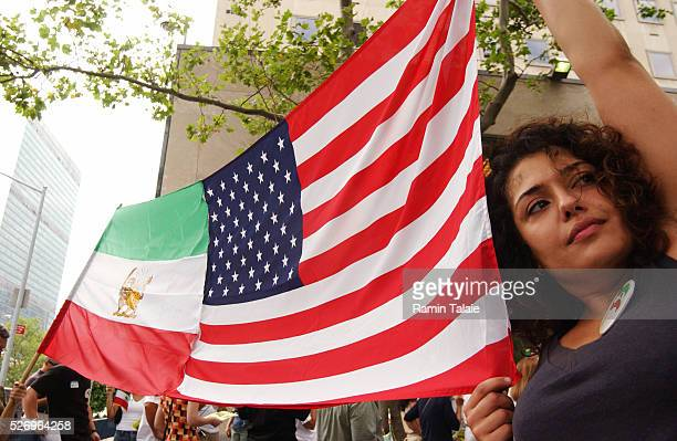 Shirin Tinati from Manhattan, holds an American/Iran flag while demonstrating with other Iranian-Americans in front of the United Nations, on the...