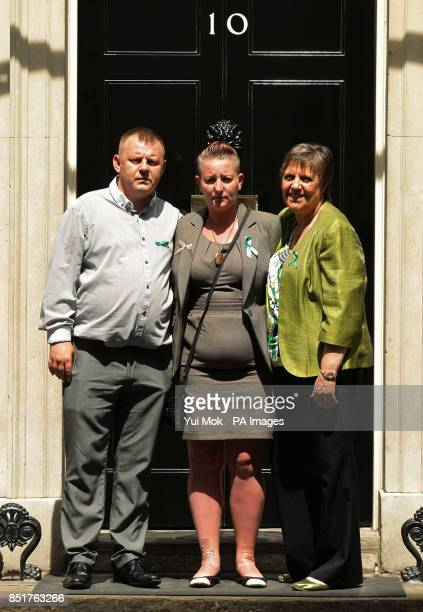 Shirley and Michael Anderson the parents of Jade Anderson who was mauled to death by dogs with Julie Hilling MP for Bolton West before handing in a...