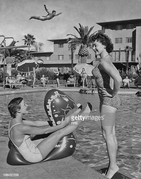 Shirley Ann Souders and Mari Anne Schmit relax by the pool at the Flamingo Hotel in Las Vegas, Nevada in 1950.