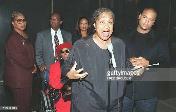 Shirley Baker, sister of O.J. Simpson, talks to the press conference 28 September at the Criminal Courts building in Los Angeles. Along with Baker...