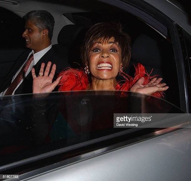 Shirley Bassey guest of honor and host at the VIP dinner party celebrating 'the eve of the festive season' leaves Papageno Restaurant on November 30...