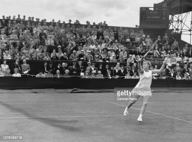 Shirley Bloomer of Great Britain reaches to make a backhand return to Alicia Guri of Spain during their Women's Singles Second Round match at the...