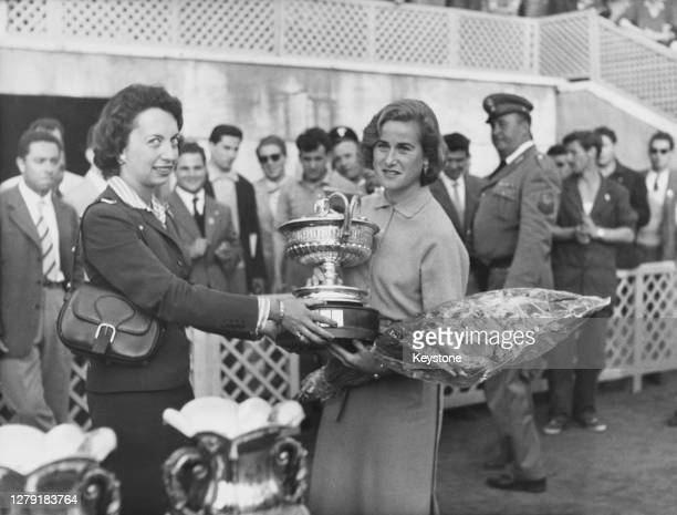 Shirley Bloomer of Great Britain receives the winner's trophy after defeating Dorothy Head Knode of the United States to win the Women's Singles...
