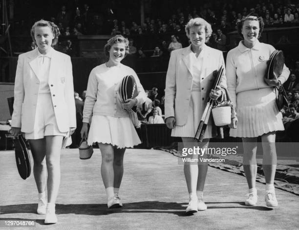 Shirley Bloomer, Pat Ward, Angela Mortimer and Anne Shilcock of Great Britain walk onto Centre Court for their Women's Doubles Final match at the...