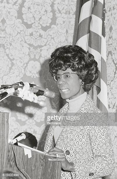 Shirley Chisholm is shown here speaking at a National Organization for Women meeting while Betty Friedan listens as a supporter