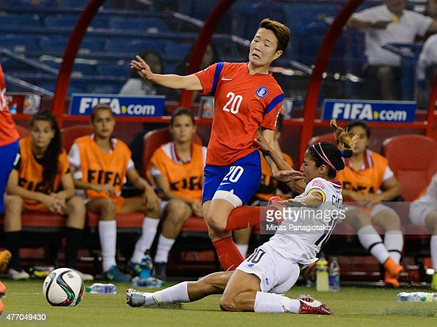 Shirley Cruz of Costa Rica challenges Kim Hyeri of Korea Republic during the 2015 FIFA Women's World Cup Group E match at Olympic Stadium on June 13...