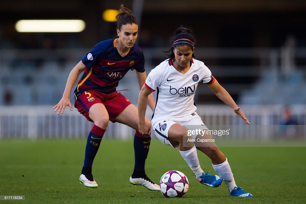 Shirley Cruz of Paris Saint-Germain protects the ball from Melanie Serrano of FC Barcelona during the UEFA Women's Champions League Quarter Final first leg match between FC Barcelona and Paris Saint-Germain at Miniestadi on March 23, 2016 in Barcelona, Spain.