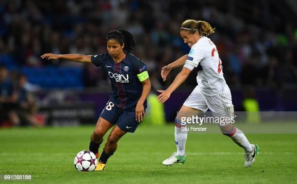Shirley Cruz Trana of Paris SaintGermain Feminines evades Camille Abily of Olympique Lyonnais during the UEFA Women's Champions League Final between...