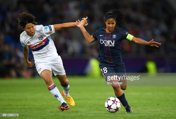 Shirley Cruz Trana of Paris SaintGermain Feminines holds off Saki Kumagai of Olympique Lyonnais during the UEFA Women's Champions League Final...