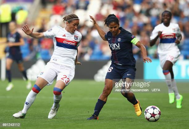 Shirley Cruz Trana of Paris SaintGermain Feminines is watched by Camille Abily of Olympique Lyonnais during the UEFA Women's Champions League Final...