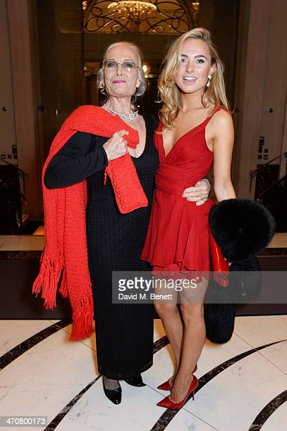 Shirley Eaton and Kimberley Garner attend a one night private view of 'Cocktails With Monroe' at the Langham Hotel on February 20 2014 in London...