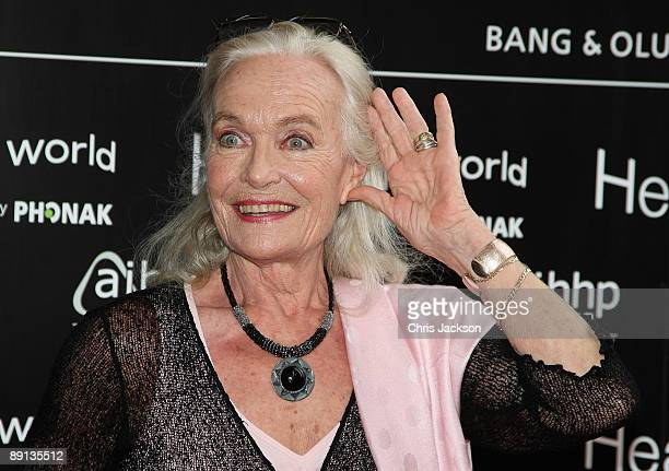 Shirley Eaton attends the Bryan Adams Hear The World Ambassadors exhibition at Saatchi Gallery on July 21 2009 in London England
