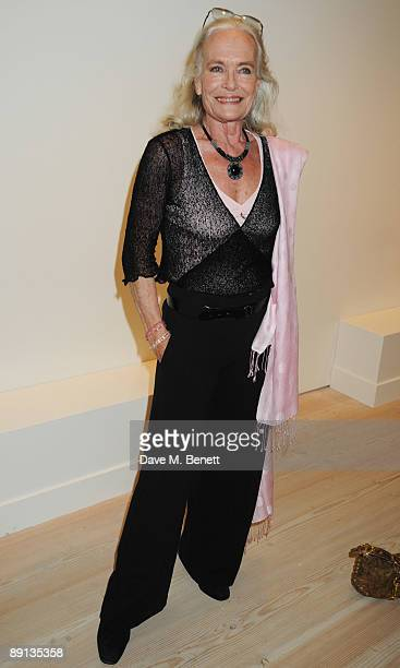 Shirley Eaton attends the Grand Opening of Bryan Adams 'Hear The World Ambassadors' Exhibition at the Saatchi Gallery on July 21 2009 in London...