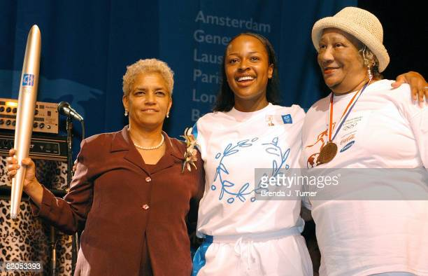 Shirley Franklin Olympic medalists Vonetta Flowers center and Alice Coachman Davis pose together after the 2004 Olympic Torch Relay