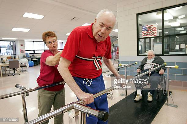 Shirley Gooding a physical therapy aid helps William Rexroat a World War II Navy veteran exercise during a therapy session as Charles Melvin Roberts...