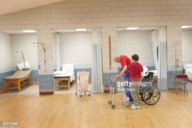 Shirley Gooding a physical Therapy Aid helps William Rexroat a WWII Navy veteran exercise during a physical therapy session at the Quincy Veterans...