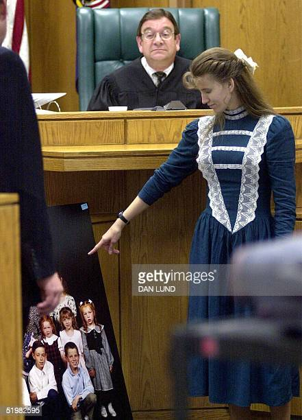 Shirley Green one of the five wives of fundamentalist Mormon Tom Green identifies her children from a family portrait 16 May 2001 at court in Provo...