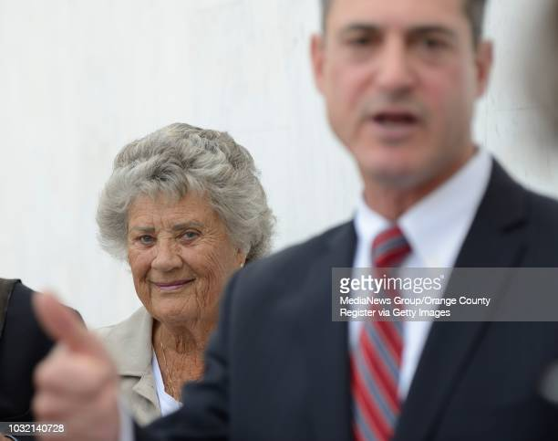 Shirley Grindle the lead author of Measure A peeks over the shoulder of Orange County Supervisor Todd Spitzer holds an impromptu press conference...