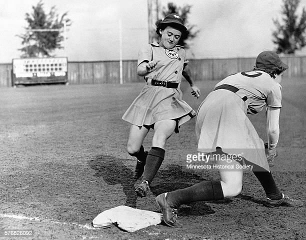 Shirley Jamison reaches third base as Ann Harnett bends down for the catch during a 1943 team practice The teammates are members of the Kenosha...