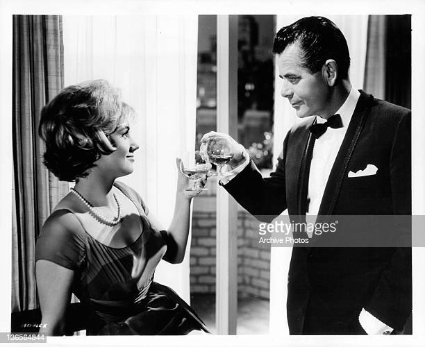 Shirley Jones and Glenn Ford toast during New Year's Eve in a scene from the film 'The Courtship Of Eddie's Father' 1963