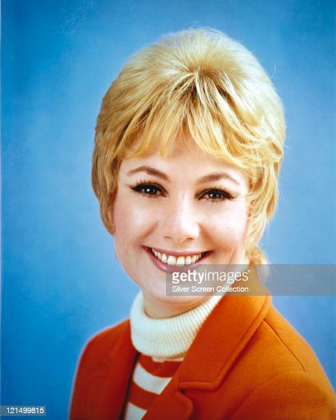 Shirley Jones US actress and singer smiling in a studio portrait against a blue background issued as publicity for the US television series 'The...