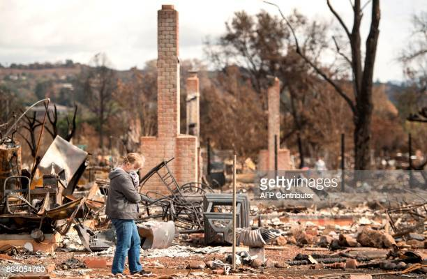 Shirley Kirk reacts while surveying the burned out property of her sister Karen Aycock who died during the fire in the Coffey Park area of Santa Rosa...
