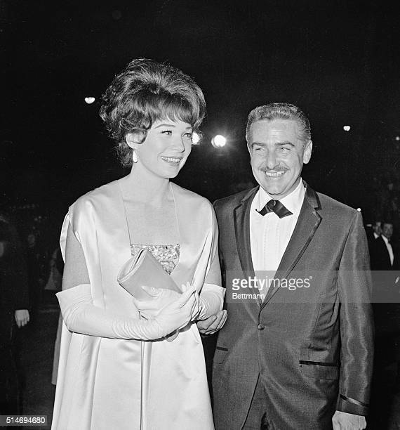 Shirley MacLaine and husband Steve Parker arrive for the 1964 Academy Awards MacLaine was nominated for the Best Actress Award for her role in Irma...