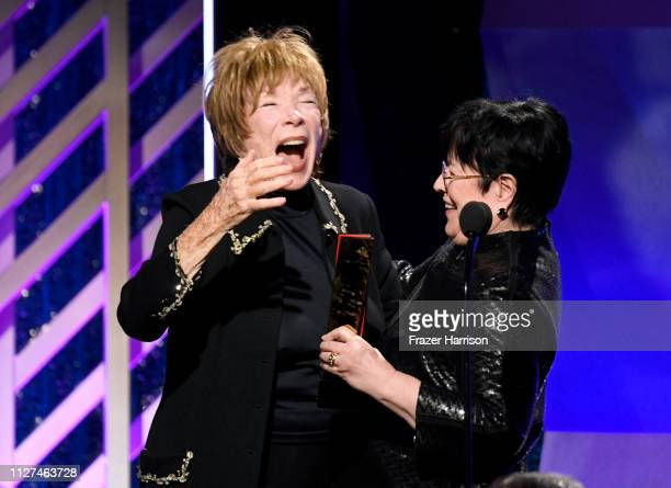 Shirley MacLaine and Kathy Bates onstage at the 18th Annual AARP The Magazine's Movies For Grownups Awards at the Beverly Wilshire Four Seasons Hotel...