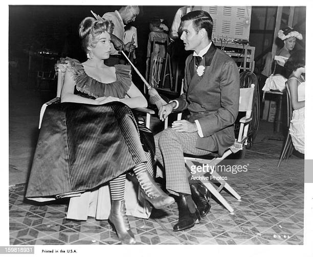 Shirley MacLaine and Louis Jourdan on set of the film 'CanCan' 1960