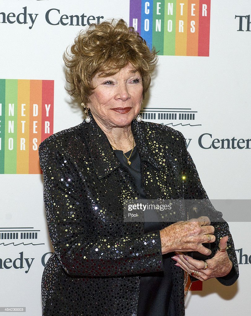 Shirley MacLaine arrives at the formal Artist's Dinner honoring the recipients of the 2013 Kennedy Center Honors hosted by United States Secretary of State John F. Kerry at the U.S. Department of State on December 7, 2013 in Washington, D.C. The 2013 honorees are: opera singer Martina Arroyo, musician/composer Herbie Hancock, singer/songwriter Billy Joel, actress Shirley MacLaine, and musician/songwriter Carlos Santana.