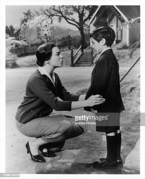 Shirley MacLaine attempts to convince young Edmund Vargas that ghosts do not exist in a scene from the film 'Two Loves' 1961