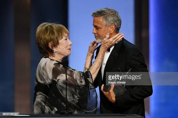 Shirley MacLaine presents the award to the 46th AFI Life Achievement Award Recipient George Clooney onstage during the American Film Institute's 46th...