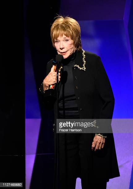Shirley MacLaine speaks onstage at the 18th Annual AARP The Magazine's Movies For Grownups Awards at the Beverly Wilshire Four Seasons Hotel on...