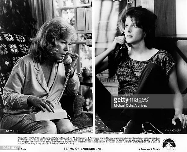 Shirley MacLaine talks on the phone Debra Winger listens on the phone in a scene from the Paramount Pictures movie 'Terms of Endearment' circa 1983