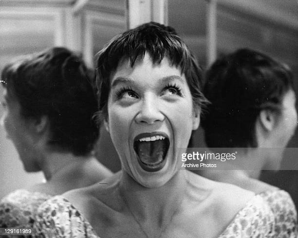 Shirley MacLaine with mouth wide open in a scene from the film 'Hot Spell' 1958
