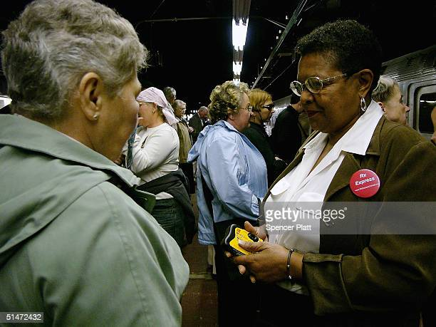 Shirley McClain speaks to other senior citizens after disembarking an Amtrak train during their trip to Canada to purchase lower cost prescription...