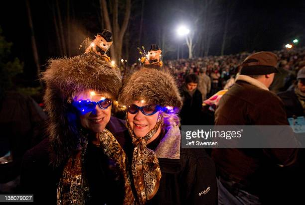 Shirley Moffatand and Joanne Alexander of Pittsburgh wait for Punxsutawney Phil to come from his den at 126th annual Groundhog Day festivities on...