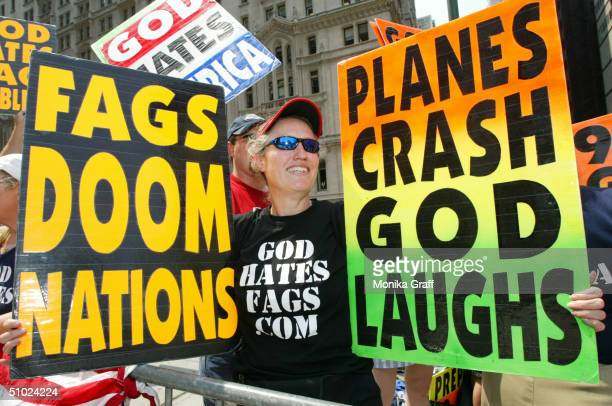 Shirley PhelpsRoper holds up signs as she joins fellow members of the Westboro Baptist Church from Topeka Kansas as they protest across the street...