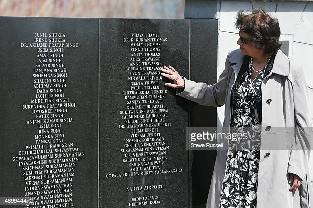 Shirley Sequeira-Travasso touches the names of her brother and Sister-in-law and their two children who died in the plane bombing. Indian Prime...