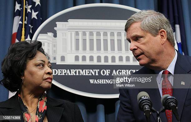 Shirley Sherrod a former USDA official and Agriculture Secretary Tom Vilsack participate in a news conference at the Department of Agriculture August...
