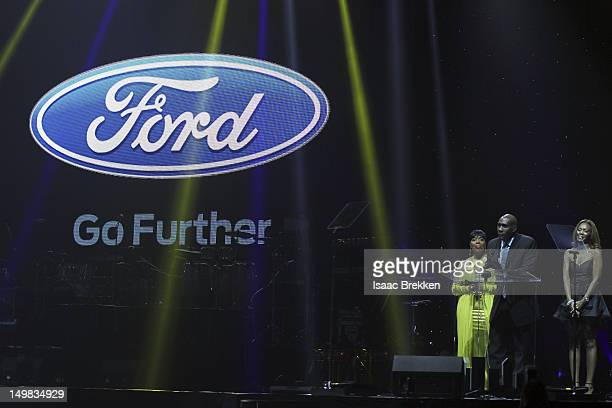 Shirley Strawberry, Morris Chestnut and Shawn Lollie of The Ford Company onstage during the 10th Annual Ford Hoodie Awards at the MGM Grand Garden...